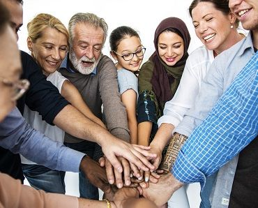 Group of people hands stack support together